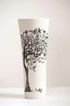 Eunice Botes - wind blowing - white porcelain with sqraffito and sprigs