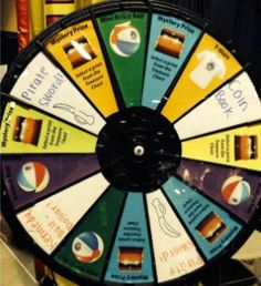 Pirate Dave wants all the young numismatists to come to Booth 978 to spin the wheel and win fun prizes.  Will you be the lucky swashbuckler who wins a T-Shirt, a Bouncy Ball, a Pirate Sword, a Kennedy Half Dollar, or even a rare Mystery Prize? Buy this Prize Wheel at http://PrizeWheel.com/products/tabletop-prize-wheels/tabletop-black-clicker-prize-wheel-18-slot/.