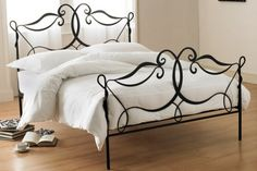 One of my favorite furniture ideas for the bedroom is a iron bed. This wonderful addition adds romance to any bedroom lacking it, and a bit of artistic whimsy, depending on choice of design. I tend to like spirals or swirls in the iron like above.