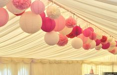 paper lanterns and pom poms decor | Paper Lanterns and Pom Poms – Perfect in Pink! | Wedding Lighting