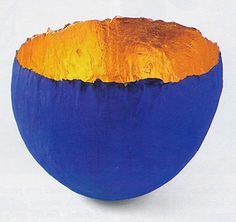Powerful Yves Klein blue and a glow of gold leaf for an opulent papier mache bowl made by Carolyn Sansbury
