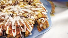 Indulge yourself with this apple-flecked sticky-bun cake, easily assembled with refrigerated cinnamon roll dough.