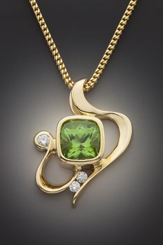 Peridot and diamond pendant by Glenn Dizon Designs.  Available for sale.  Inquire at info@glenndizon.com.  Thanks