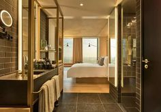 Known for its beautiful rooftop greenhouse, QO Amsterdam is another excellent place to consider for your stay in the city. The hotel is minimalist yet grand.#hotelsinamsterdam #hotelsinamsterdamcentral #hotelsinamsterdambest #amsterdambest #amsterdamhotels #amsterdamhotelsluxury #wheretostayinamsterdamhotels Modern Bathroom Design, Bathroom Interior, Fletcher Hotel, Victoria Hotel Amsterdam, Hostels, Hotel Room Design, Hotel Interiors, Hotel Suites, Hotel Reviews