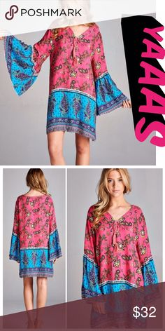 BOHO BEAUTY! Boho contrast paisley print dress or long tunic in turquoise and hot pink. Pretty bell sleeves complete this gypsy soul look. Rayon blend. tla2 Dresses