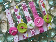 Decorative Decoupaged clothespins with buttons from Etsy shop Custom Creations by Christy.