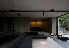 Mountain Retreat by Fearon Hay Architects. Black track lighting. Exposed concrete ceiling.