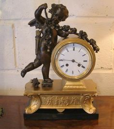 A FRENCH EMPIRE STYLE MANTEL CLOCK C1880