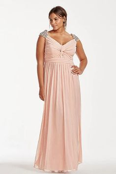 Plus size evening dresses with cap sleeves are available. This empire waist evening gown has a ruched bodice. The flowing chiffon skirt is full and moves from the upper waist. The neckline on this plus size fashion piece is a modest v neck. Beading on the top of the shoulders add bling to the plus size design. See other plus size evening dresses for inspiration at http://www.dariuscordell.com/featured_item/plus-size-evening-dresses-plus-size-ball-gowns/