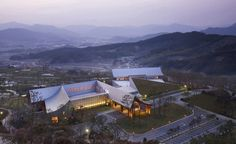 Image 1 of 13 from gallery of Lake Hills Suncheon Golf Resort / Ken Min Architects. Photograph by Kim Yong Kwan Clubhouse Design, Golf Tips For Beginners, Smart City, Landscape Architecture, Resorts, Paris Skyline, Mansions, House Styles, Gallery