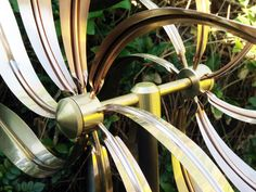 Kinetic garden sculpture | our kinetic copper wind sculptures and spinners are handcrafted of 100 ...