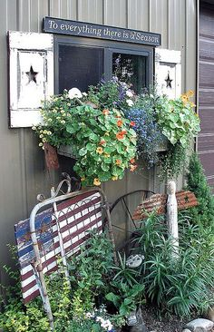 Garden art with star shutters, window box, and old gate