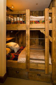 This bunk room makes use of an odd space and provides bed space for two full beds.