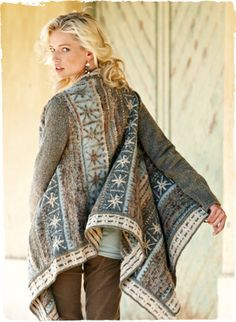 Snowflakes are knit in a wintry palette of blue grey, ivory, pewter and tan. Our dramatic waterfall cardigan cascades in frothy bouclé yarns of alpaca (45%), pima (39%), wool (12%) and nylon (4%).
