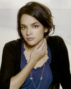 Norah Jones has a short bob with small waves.