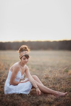 boho chic sitting in a field