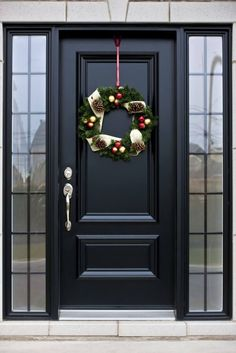 Pictures of Black Front Doors (Front Entry) Here's a truly bespoke black door, with silver hardware, flanked by a pair of smoked glass windows.Here's a truly bespoke black door, with silver hardware, flanked by a pair of smoked glass windows. Front Door Porch, Front Door Entrance, Exterior Front Doors, House Front Door, Glass Front Door, Front Entrances, Front Entry, Front Door Decor, Front Door Hardware