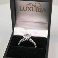 High quality cubic zirconia engagement rings from the Luxuria brand use the highest grade CZ. The ring has a hearts & arrows (H & A) pattern central stone. Cubic Zirconia Engagement Rings, Diamond Simulant, Heart With Arrow, Jewelry Branding, Heart Ring, Tiffany, Wedding Rings, Band, Inspired