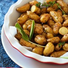 Healthy roasted Teeny Tiny potatoes side side recipe with thyme, sea salt, smoked paprika, olive oil and ghee. Kids lunch box meal for school or work.