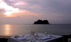 Vomo Fijian Resort, Private sunset dinner by the sea.