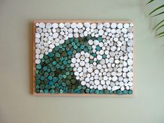 This gorgeous hanging abstract art is made from slices of driftwood personally selected for quality from the fresh water shores of lake Erie. The focal point of this piece is an abstract wave. You can almost hear the sound it would make! The slices of driftwood were dyed white and blue, then varnished to seal in the color. The piece was then framed on 4 sides to complete the effect. Composed on a light weight board overlayed with cork to give a nice texture to the background. Comes pre-hung…