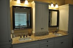 cabinet between sinks in master bathroom to use space
