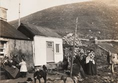 Women and children with their dogs gathered around the St Kilda post office. Picture: University of Glasgow