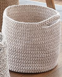 Chunky baskets, single crochet with a large hook. You can customize the size of the basket by changing the hook size. Takes 5 skeins of either Big Ribbon or Big Ribbon Plus -- great for yarn storage.