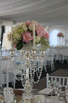 This is one of our beautiful silver and crystal candelabras topped with a huge bouquet of peonies, roses, hydrangeas and a little babys breath. Caversham House Swan Valley,Perth Western Australia.