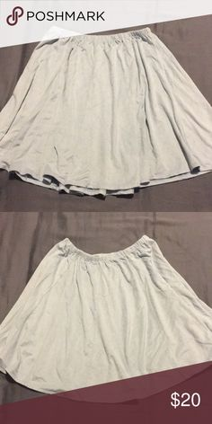 Brandy Melville skirt Never worn. Color is a blue grey Brandy Melville Skirts Mini