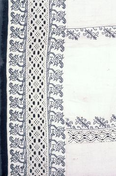 """Textile, 16th century White linen frontal made in eleven perpendicular panels of linen, which are outlined in narrow border of embroidery, stylized vine, in blue silks. Insertions of needlepoint lace, (four) also perpendicular; accross bottom a wider band of blue embroidery, a band of lace insertion, and another band of embroidery. Edged with narrow blue silk fringe. Stitch """"punto scrito"""" - counted running."""