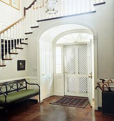 Wide archway with closets in it. I like this design also between a living/family room and an office/library. When pocket doors or french doors are installed in both walls (on each side of the arch) this creates a lot of separation and privacy. In addition to closets, the inner arched nook can house art niches and/or bookshelves.   Domino Magazine photo.