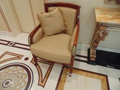Lot 125 - Italian Neoclassical walnut and parcel gilt upholstered Bergere, upholstered in gold fabrics 550mm