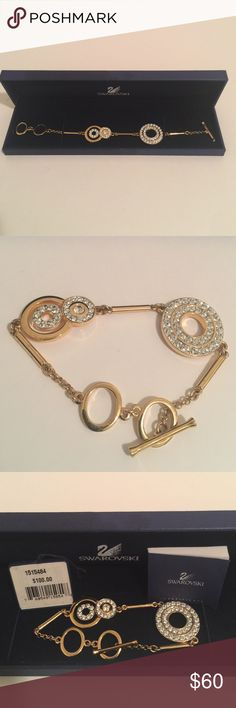 """Swarovski Crystal 18k Gold Bracelet Brand new, worn for two hours. 8.25"""" long, largest ring with double row of crystals is 1"""" in diameter, middle size ring is 3/4"""" and smallest ring with crystal in center is .25."""" Toggle insert has crystals on both ends. Swarovski Jewelry Bracelets"""
