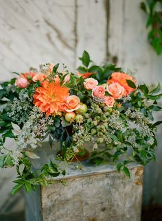 gorgeous seasonal flowers: dahlias, evelyn garden roses, pomegranates, acorns, eucalyptus seeds, and porcelain berry vine. Silvana di Franco, Max Gill