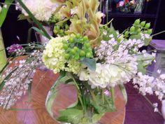 White hydrangea, bear grass, green orchids, hypericum berries