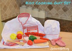 Establishing Healthy Eating Habits – Kids Cooking Gift Set | A child's chef hat and jacket, along with wooden fruits and vegetables they can chop in half, are toys that get kids interested in cooking and healthy eating.