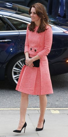 The Duchess of Cambridge displayed her Jackie Kennedy-style ladylike chic today as she stepped out in a red and white gingham check two piece
