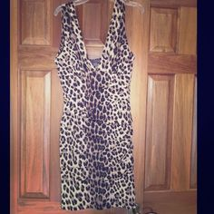 Forever 21 bodycon dress Cute and sexy cheetah print dress. Hugs your curves, plunging neckline, and rouching on the bodice. Only worn once. Forever 21 Dresses