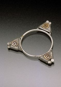 Ring | Chuck Domitrovich. 'Wrapped Triangle'  Sterling silver, fine silver, and 14k gold