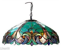 EILEEN, a Victorian ceiling pendant fixture, is handcrafted with pure stained glass. Add that touch of class to your room or office with this beautifully handcrafted ceiling pendant fixture! Ceiling Mount Canopy (in) Pendant Chandelier, Pendant Light Fixtures, Ceiling Pendant, Ceiling Lights, Light Pendant, Kitchen Lighting, Farmhouse Lighting, Chandelier Lighting, Stained Glass