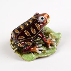 ribbet. ribbet. I'm a frog or a toad on a lilly pad. I am also a trinket box so I open and close. I like to eat jewelry.
