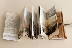 """London Book by Kaija (Paperiaarre). Accordion book - cardstock, vintage illustrations, vellum paper, recycled kraft papers, tissue paper watercolour, ink, pencil, pen, eyelets, vintage ribbon. 6,5x15x1cm / 2.6""""x5.9""""x0.4"""""""