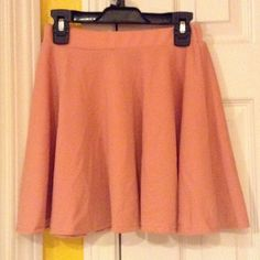 Brand New Petite Pink Skirt Brand new with tags. From Korea. Says size M but runs a small (wouldn't recommend for taller people). Pink but the pictures make it look a bit orange, the first photo is the closest to the real color. Very cute and comfortable! No stains or holes. Skirts Circle & Skater