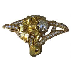 Art Noveau ring France ca 190o Central old cut diamond,surround display of rose cut diamonds ,18 k gold			                                                                                                                                ...