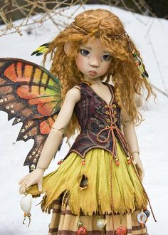 Make a Tattered & Stained Fairy Skirt Tutorial   The instructions are for the tattering and staining of the skirt fabric, and do not include an actual skirt pattern. if you would like to buy the Doll you need to contact the Artist http://www.antiquelilac.com/dolls-for-sale.html   here is the link to contact her