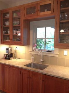 light counter tops with cherry wood, light back splash