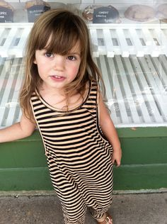 striped harem pant romper and bangs?? she's too cool.