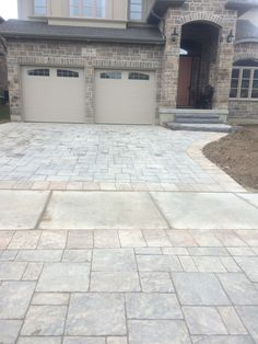 A driveway installed using Permacon's Amalfi paver. Work done by Prestige Landscaping