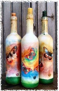 Bottiglie portacandela decorate a mano